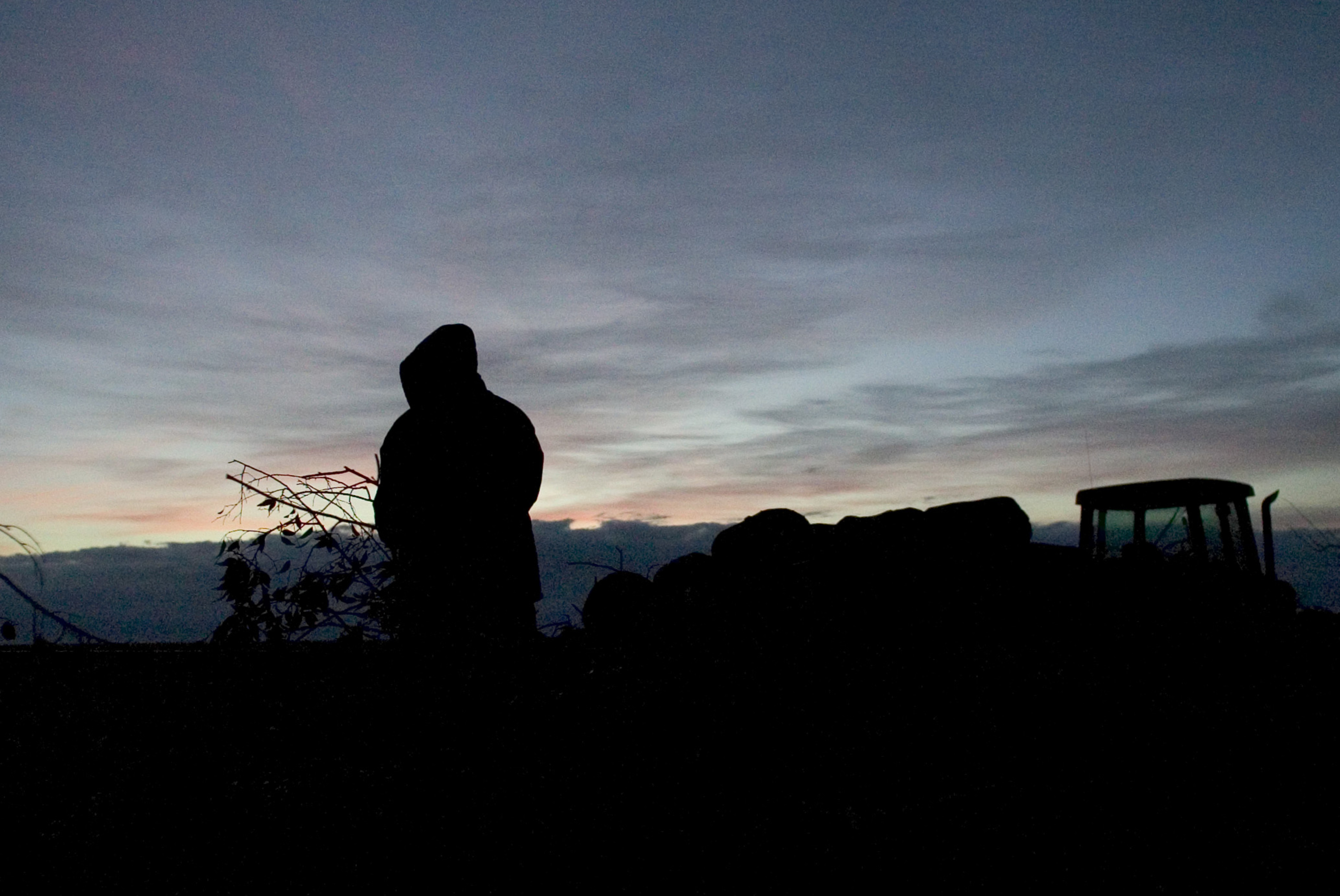 A man is silhouetted in the early morning hours near Huron, California. 2007