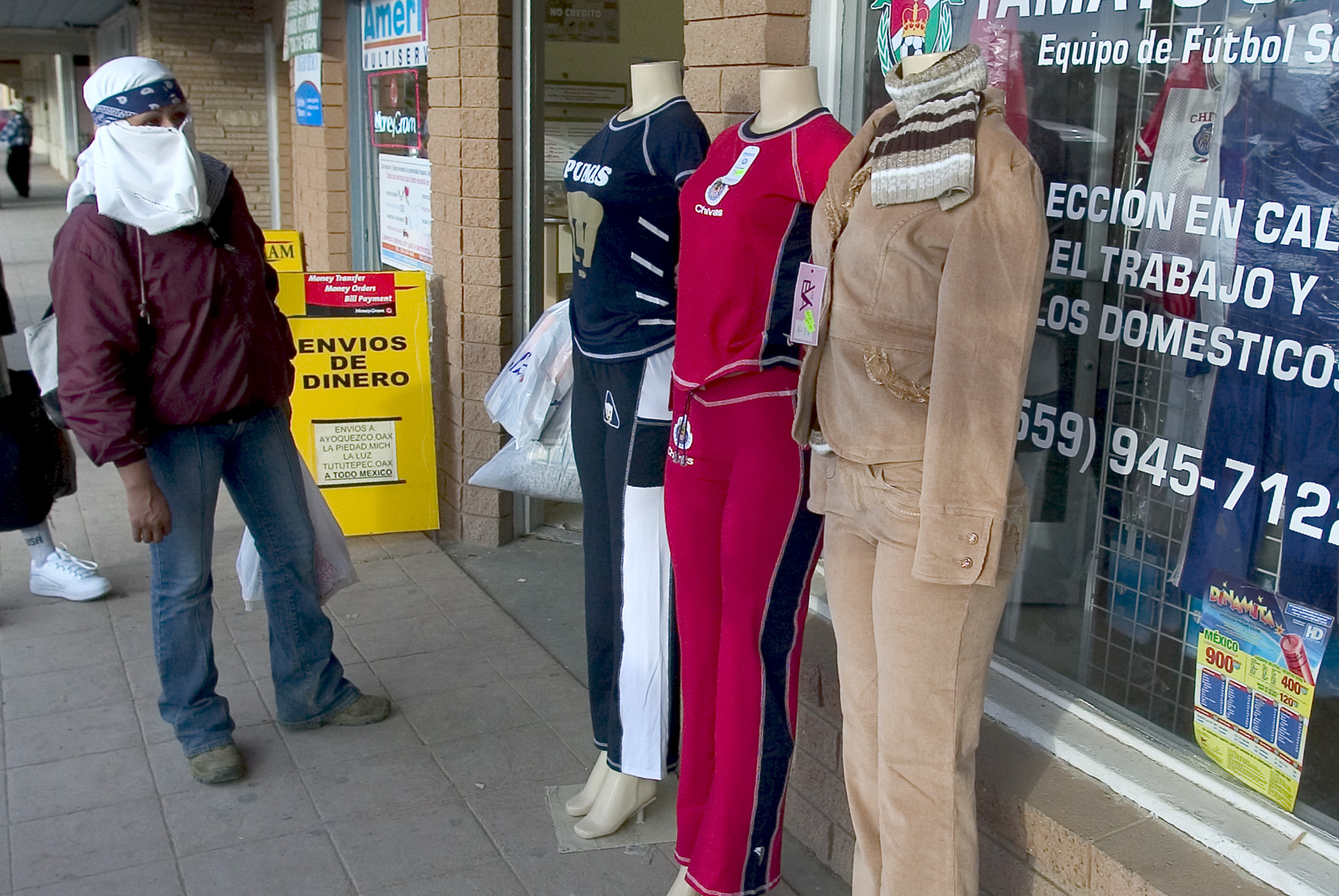 A woman in Huron looks at outfits at a clothing store. 2007