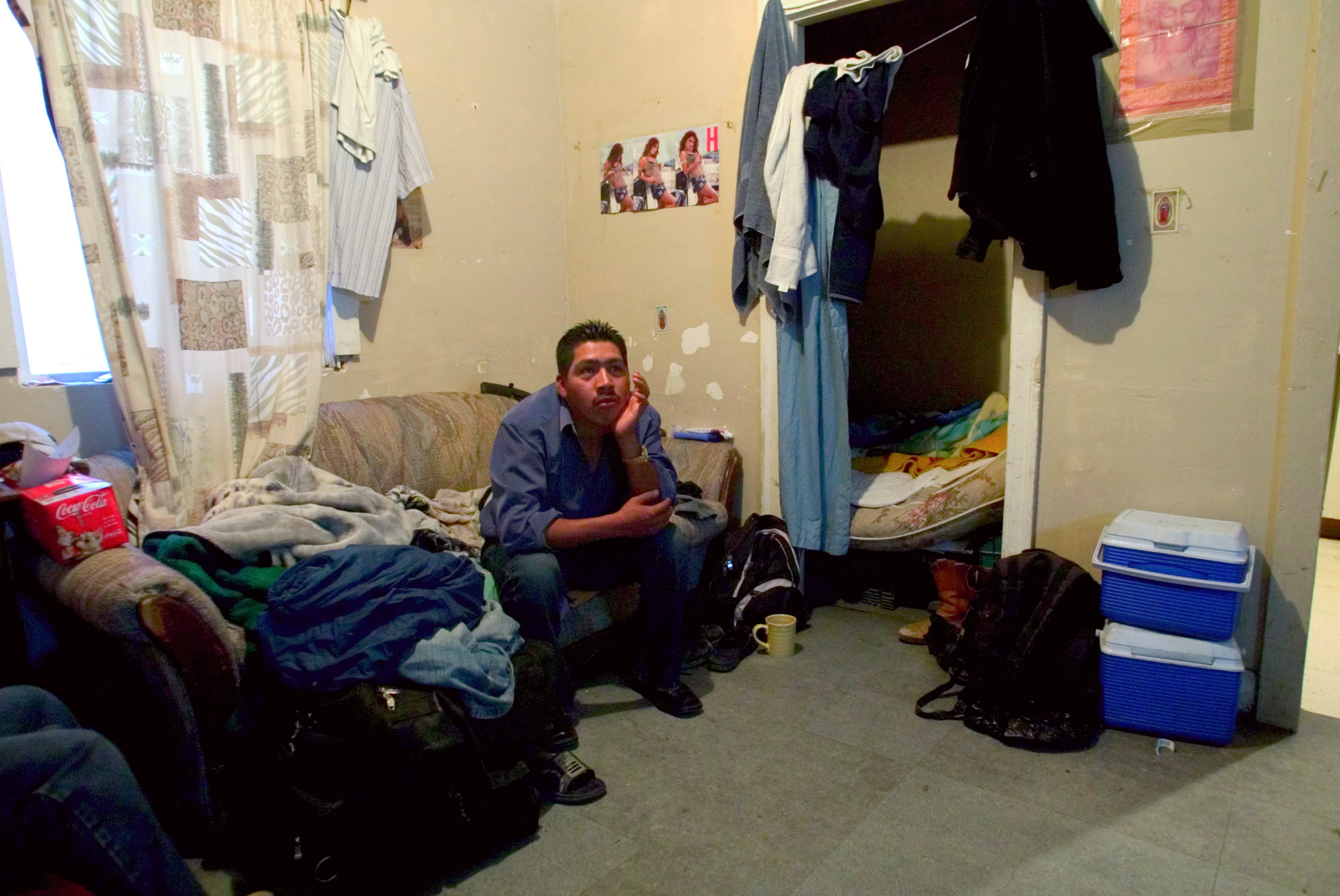A man who goes by Rigo, sits in his room in Huron, California. 2007