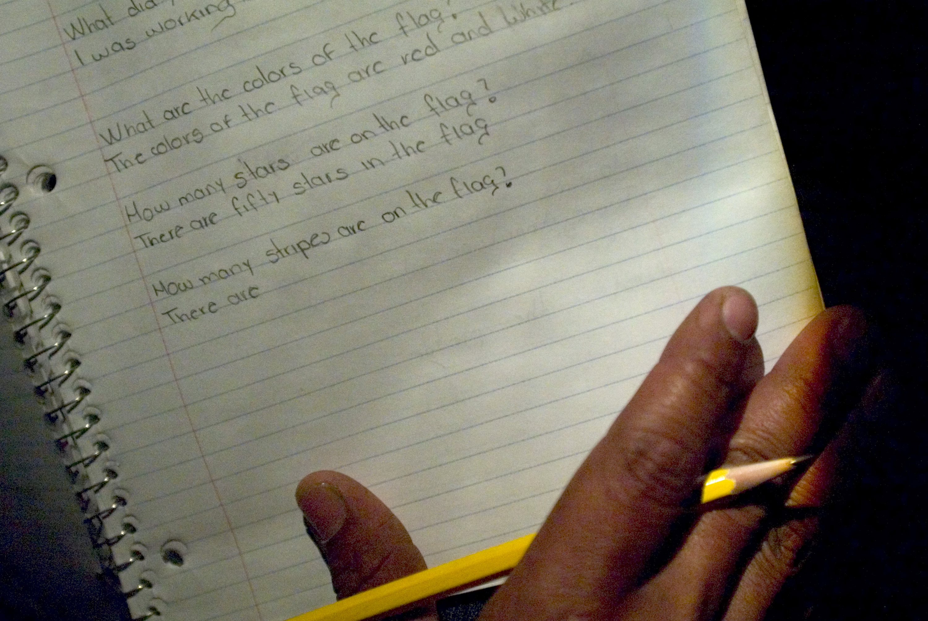 Rigo practices school work in preparation to one day take immigration tests.